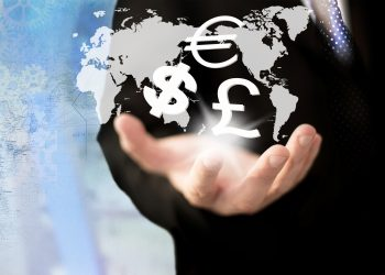 Investment concept. Businessman holding currency symbols.